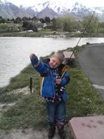[Photo: Faythe at Salem Pond holding a fish]