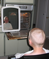 [Photo: Faythe getting his head shaved]