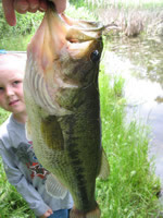 [Photo: Faythe and the big bass]