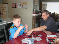 [Photo: Faythe and Terry play with Legos]